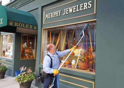 Cleaning the Windows of Murphy's Jewlers